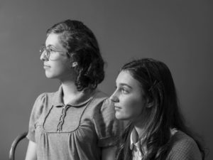 Photo of Giverny Burke as Margot Frank and Abby Matt as Anne Frank